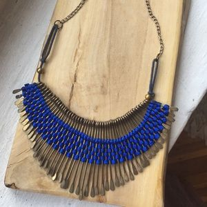 Regal gold/ metal necklace with blue string